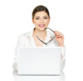 Beautiful smiling woman sits thñƒ table laptop white shirt isolated white Stock Photography