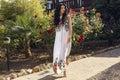 Beautiful smiling woman walking barefoot beside a villa Royalty Free Stock Photo