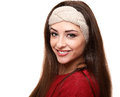 Beautiful smiling woman in warm headband isolated on white Royalty Free Stock Images