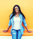 Beautiful smiling young african woman wearing a jeans clothes Royalty Free Stock Photo