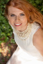 Beautiful smiling young redhead woman portrait outdoor Royalty Free Stock Photography