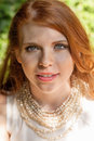 Beautiful smiling young redhead woman portrait outdoor Royalty Free Stock Images