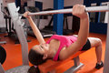 Beautiful smiling young woman exercising weights gym Royalty Free Stock Photo