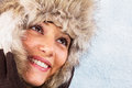 Beautiful smiling young woman with fur hat Stock Images