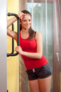 Beautiful smiling young woman in the gym Royalty Free Stock Photos