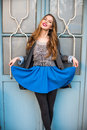 Beautiful smiling young woman posing wearing casual clothes and blue skirt Royalty Free Stock Photo