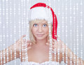 Beautiful smiling young woman in Santa Claus hat Stock Image
