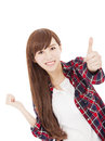 Beautiful smiling young woman standing with thumb up on white background Royalty Free Stock Images