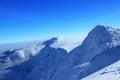 Beautiful snow capped mountains against the blue tatras sky Stock Photos