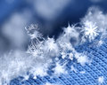Beautiful snowflakes on blue woven wool Royalty Free Stock Photo