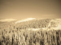 Beautiful snowy winter landscape in a mountain ski resort, retro sepia style Royalty Free Stock Photo