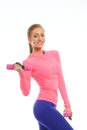 Beautiful sort girl doing fitness exercise with dumbbells Royalty Free Stock Photography