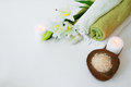 Beautiful spa composition with lily flowers, towels, soap, bath salt and candles Royalty Free Stock Photo