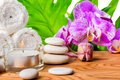 Beautiful spa concept  with blooming lilac orchid, white stones, Royalty Free Stock Photo