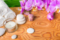 Beautiful spa setting with blooming lilac orchid, white stones, Royalty Free Stock Photo
