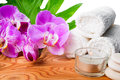 Beautiful spa still life with blooming lilac orchid, white stone Royalty Free Stock Photo