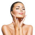 Beautiful spa woman beauty portrait touching her face Stock Photo