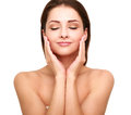 Beautiful spa woman with clean beauty skin touching her face Royalty Free Stock Photo