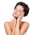 Beautiful spa woman touching her face isolated Stock Images