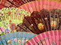 Beautiful spanish fans close up of a selection of brightly coloured floral Royalty Free Stock Image