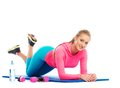 Beautiful sport girl doing fitness exercise on a floor mat Royalty Free Stock Photo