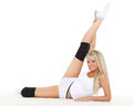 Beautiful sporty woman does exercises white background fitness Stock Image
