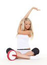 Beautiful sporty woman does exercises white background fitness Royalty Free Stock Photo