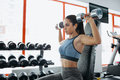 Beautiful sporty woman doing power fitness exercise at sport gym. Royalty Free Stock Photo