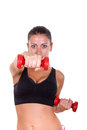 Beautiful sporty woman exercising and lifting weights dumbbells young focus on Royalty Free Stock Photography