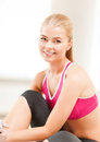 Beautiful sporty woman having break in gym fitness people and exercise concept Royalty Free Stock Image