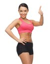 Beautiful sporty woman picture of showing thumbs up Royalty Free Stock Photo