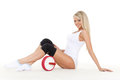 Beautiful sporty woman roller slider sits white background fitness Royalty Free Stock Photo