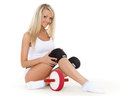 Beautiful sporty woman roller slider sits white background fitness Royalty Free Stock Photography