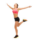 Beautiful sporty woman running or jumping fitness sport training exercise gym and lifestyle concept Royalty Free Stock Image