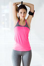 Beautiful sporty young woman doing exercise in gym. Royalty Free Stock Photo