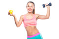 Beautiful sporty young woman with a dumbbell and an orange again Royalty Free Stock Photo