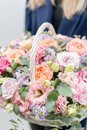 Beautiful spring bouquet in wicker basket. Arrangement with various flowers. The concept of a flower shop. A set of Royalty Free Stock Photo