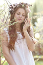 Beautiful spring nymph with flower crown dreamy light portrait Royalty Free Stock Image