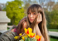 Beautiful spring portrait with tulips. Stock Photos
