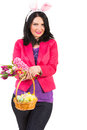 Beautiful spring woman with bunny ears holding fresh flowers and easter basket with eggs isolated on white background Royalty Free Stock Photos