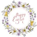 Beautiful spring wreath of daffodils and purple flowers on a white background.