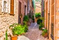 Beautiful street alley in mediterranean village on Majorca Spain Royalty Free Stock Photo