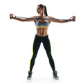 Beautiful strong model performs exercises for the muscles of the chest using an  resistance bands Royalty Free Stock Photo