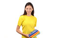 Beautiful student in yellow blouse holding books summer isolated on white Royalty Free Stock Photo