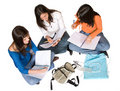Beautiful students studying on the floor Royalty Free Stock Photo