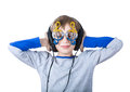 Beautiful stylish blond child wearing big professional headphones and funny glasses listens to music with his eyes closed Royalty Free Stock Image