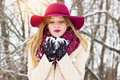 stock image of  Beautiful, stylish and young girl, blowing the snow from her hands. Fashion.