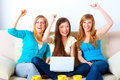 Beautiful successful girls with laptop Stock Images