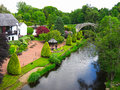 Beautiful summer garden with a river Stock Photo