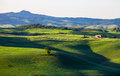 Beautiful summer landscape with wavy hills and a lodge, Tuscany, Royalty Free Stock Photo